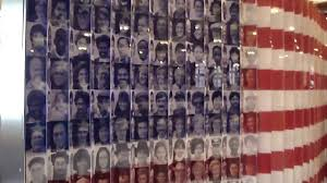 Flag Of New York City The American Flag Of Faces At The Top Of Empire State Building New