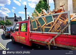 london england uk recycling van carrying old chairs and