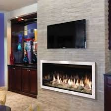 gas fireplace with a concrete fireplace surround and floating
