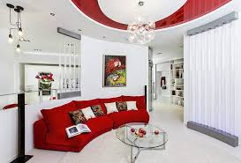 red velvet sofa with round glass table and sparkling lamps decor