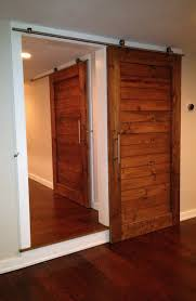 Sliding Bypass Barn Door Hardware by Barn Door Interior White Plywood Sliding Barn Door Ideas Along