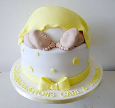 baby shower cake miss cupcakes archive 2 tiered yellow baby bottom baby