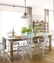 hanging light fixtures over dining table with lights above and 1