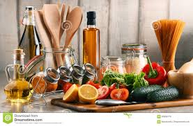 composition with assorted food products and kitchen utensils stock