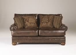 Brown Leather Sofa And Loveseat Ashley Brown Leather Durablend Antique 2pc Sofa Package By Ashley