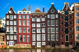 medieval cute houses in amsterdam the netherlands stock photo