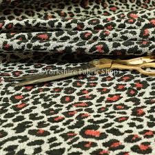 leopard animal skin inspired spotty black red white colour