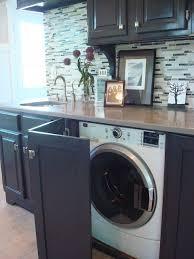 machine a laver dans la cuisine cacher le lave linge dans la cuisine avec une porte rabatante
