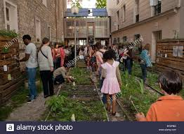 families visiting community garden low income