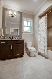 bathroom with drop in bathtub specialty tile floors in