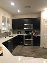 how to clean espresso cabinets paint color for kitchen with espresso cabinets gray backsplash