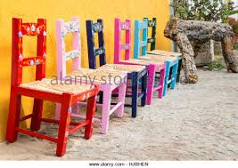 colored wooden chairs stock photos colored wooden chairs stock