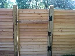 horizontal wood fence gate custom designed by mossy oak fence