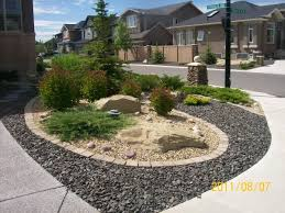 driveway landscaping for a corner lot done with xeriscaping this
