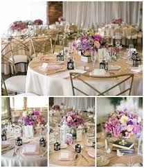 low pink and purple wedding centerpieces at wedding reception with