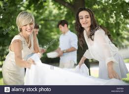 Setting A Table by Two Women Setting A Table Outside Stock Photo Royalty Free Image