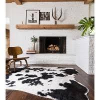 Faux Cowhide Rugs Interior Zebra Skin Rug With Cream Velvet Chair Having Carved