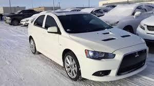 mitsubishi car white pre owned white 2012 mitsubishi lancer tc sst ralliart awd review