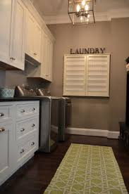 Laundry Room Sink Cabinets by Inset Soft White Cabinets Shiloh And Honed Black Granite