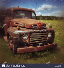 Vintage Ford Truck Grill - rusty old ford truck in a field alberta countryside canada