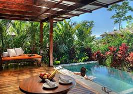Tropical Backyard Ideas Tropical Backyard Design With Wooden Table And Small Pool