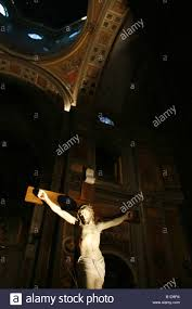 statue of jesus christ on cross inside church in rome italy stock