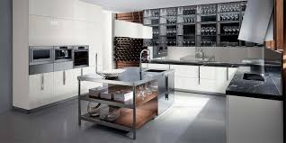 mirror backsplash in kitchen wooden island with stainless steel countertop dark wooden cabinets