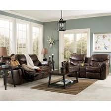 Brown Leather Sectional Sofa by Chocolate Brown Leather Sectional W Round Ottoman Home Decor