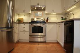 How To Install Under Cabinet Lighting by Furniture Black Kitchen Cabinets With Cenwood Appliance And Under
