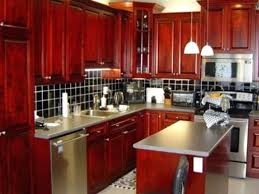 pictures of red kitchen cabinets red kitchen cabinets i like this rustic island although red kitchen