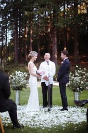 wedding arch no flowers pink peonies navy blue tux amazing back of dress no earrings
