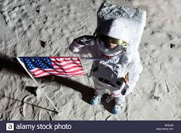 Picture Of Flag On Moon An Astronaut On The Surface Of The Moon Saluting An American Flag