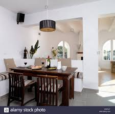 dark wood table and chairs in modern open plan coastal dining room