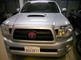 toyota trucks emblem pink painted toyota grille emblem dscn4128 jpg tacoma