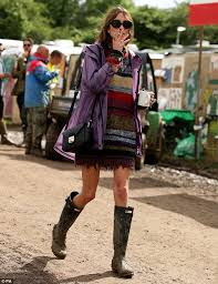 alex chung rocks shabby chic as she braves the rain at glastonbury