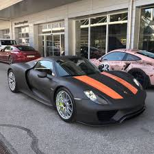 electric porsche 918 porsche 918 spyder gets matte black wrap with lava orange stripes