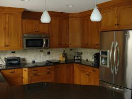 brookhaven colony nutmeg on maple with cambria countertops