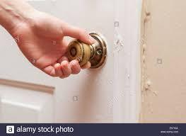 hand opening door knob stock photo royalty free image 72069434