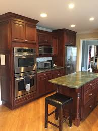 oak kitchen cabinets with stainless steel appliances gorgeous omega wood cherry complete kitchen new stainless steel appliances dacor granite green kitchens