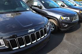 light blue jeep cherokee jeep and suzuki may have violated emissions rules fortune