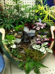 water feature designed by kristin middleton broken pot fairy