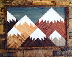 one of a wood wall reclaimed wood geometric wood