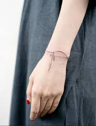 the 25 best wrist bracelet tattoos ideas on pinterest simple