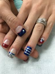 4th of july gel nails red white silver glitter and blue french