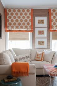 Printed Fabric Roman Shades - colorful printed roman blinds add a pop of color to this space