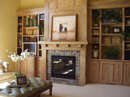mission style fireplace living room built in books shelves slate