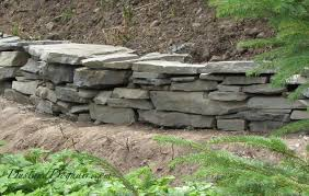 diy stacked stone garden wall hometalk