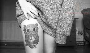 tattoo girl owl black eyed owl tattoo on girl thigh