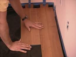 Installing Laminate Flooring On Concrete How To Install Snap Together Laminate Flooring How Tos Diy