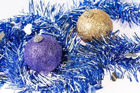 purple and gold ornaments on tinsel decoration background stock